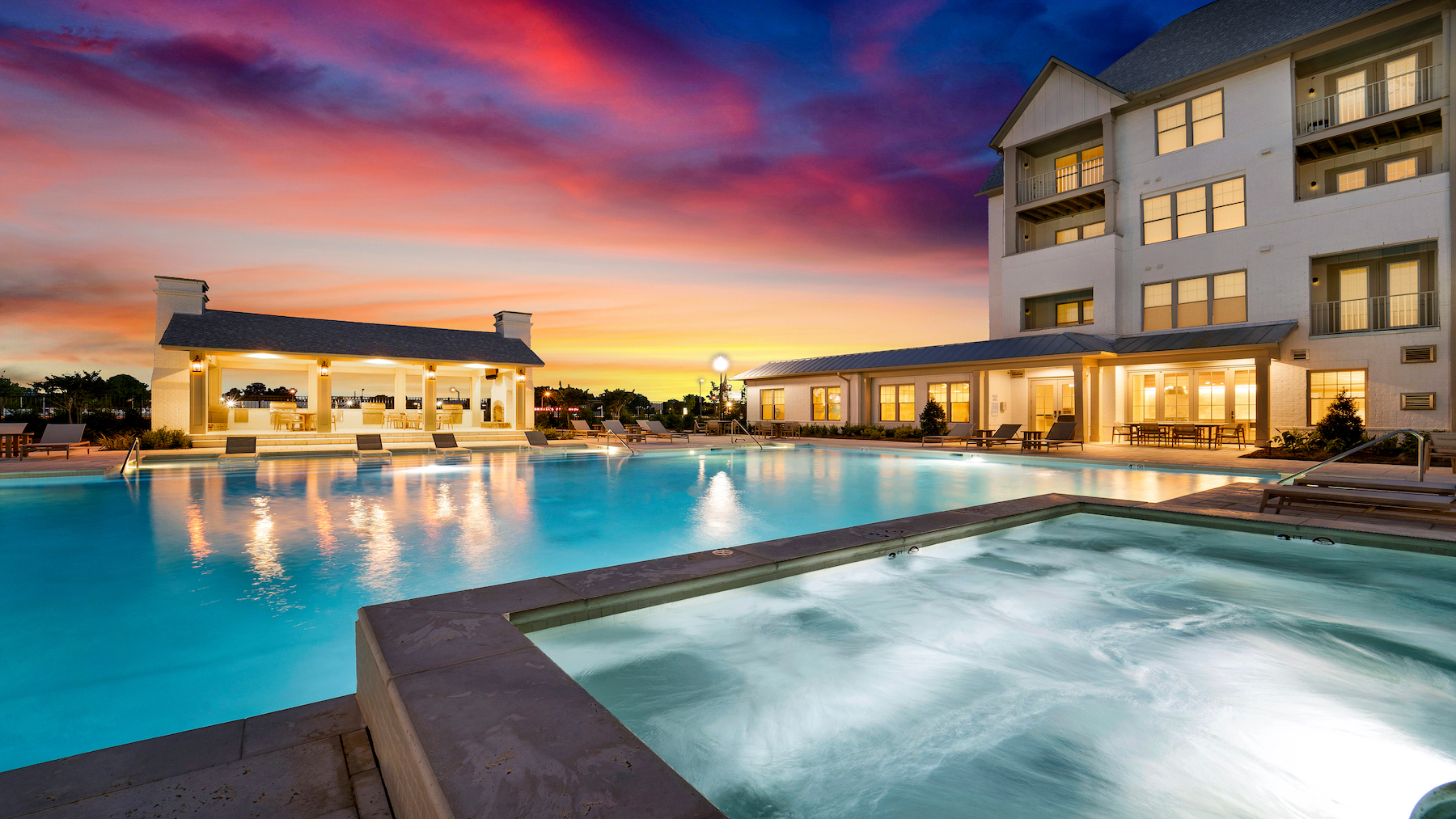 View of Highland at Spring Hill at sunset by the pool and spa